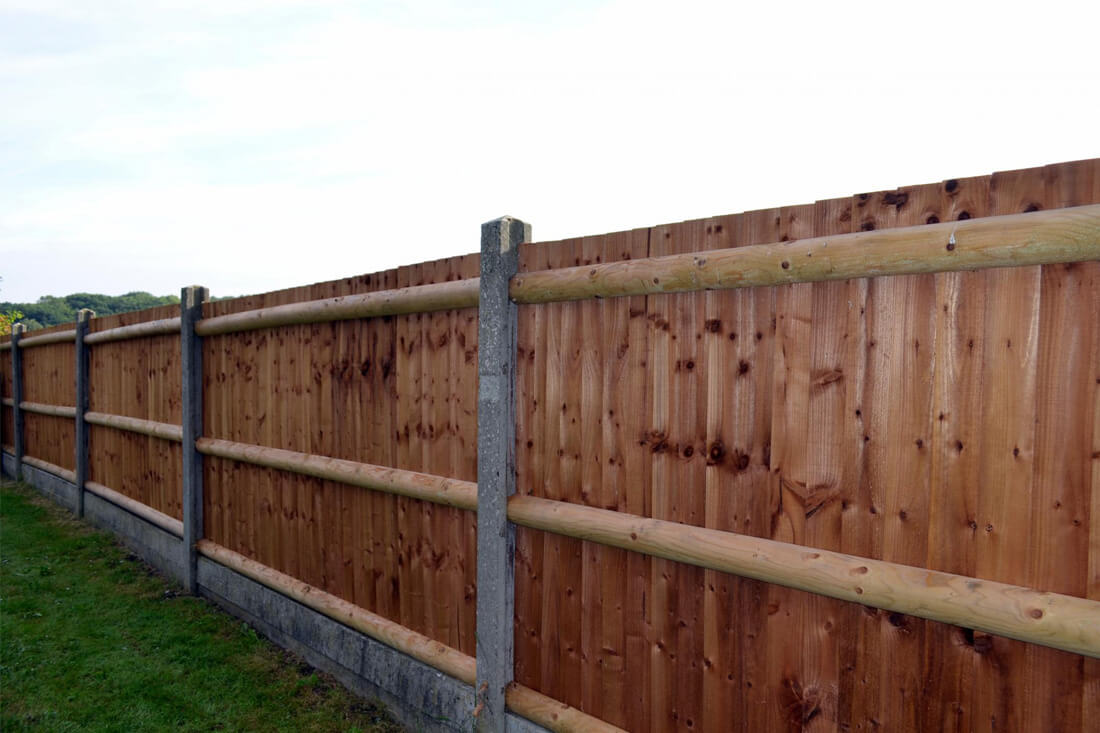 fencing company with a wood fence